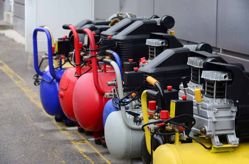 a row of air compressors pumps of different sizes