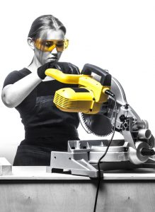 image of lady running miter saw