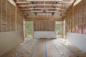 image of partially sheetrocked livingroom with studs visible