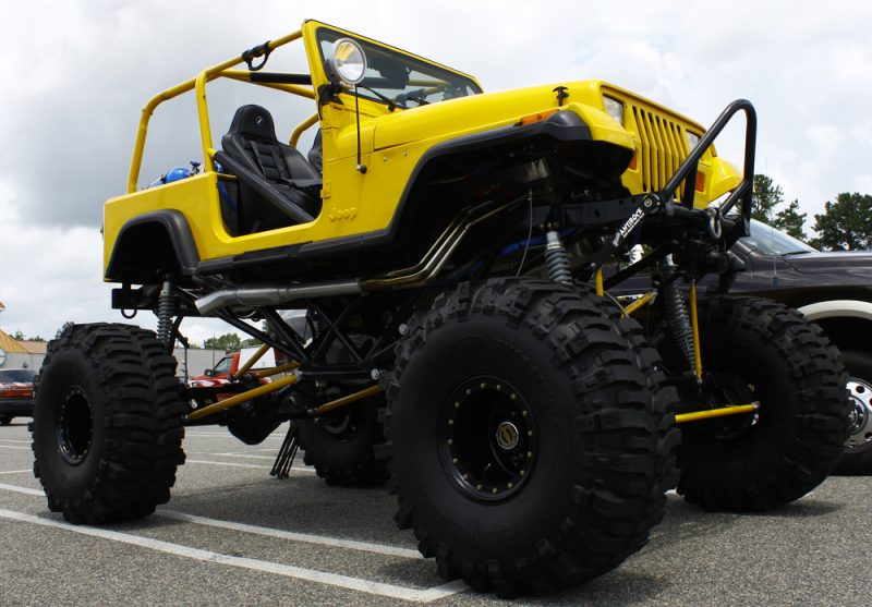 image of yellow jeep wrangler with excessive lift