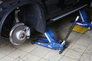 Image of a car lifted on two jacks