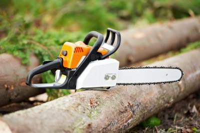 clean chainsaw sitting on log